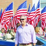 Lt. governor in front of flags