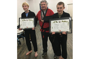 Local youth earn Black Belts